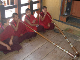 Young monks practise on telescopic trumpets